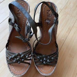 One strap broken on left shoe